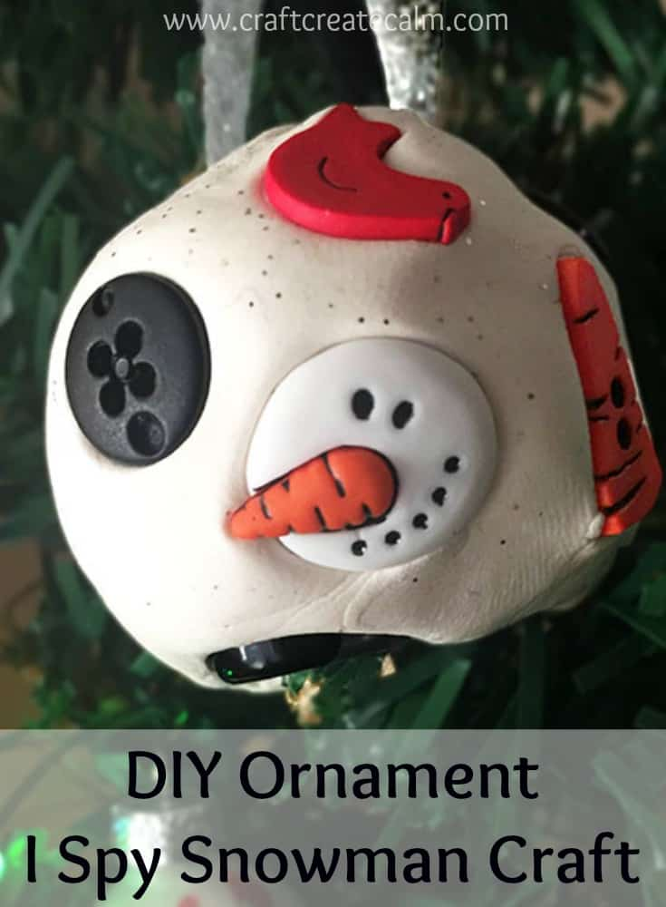 DIY ornament i spy snowman craft. Cute snowball with snowman parts for an i spy activity.