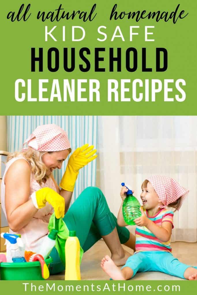 mom and toddler wearing cleaning gloves and laughing while spraying each other with all natural chemical free kid safe cleaner DIY homemade by The Moments At Home