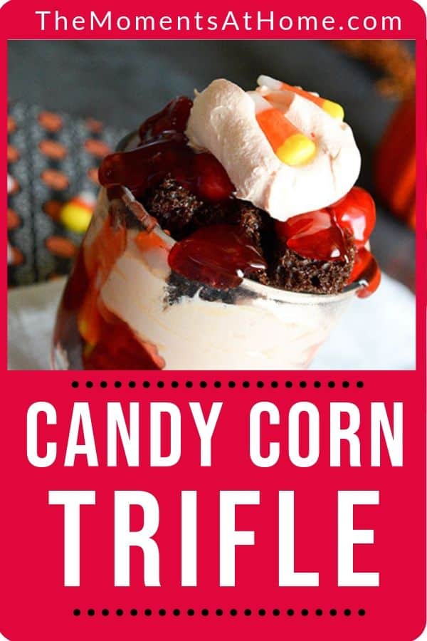 A picture of chocolate cake trifle with cherries and candy corn for a harvest party dessert