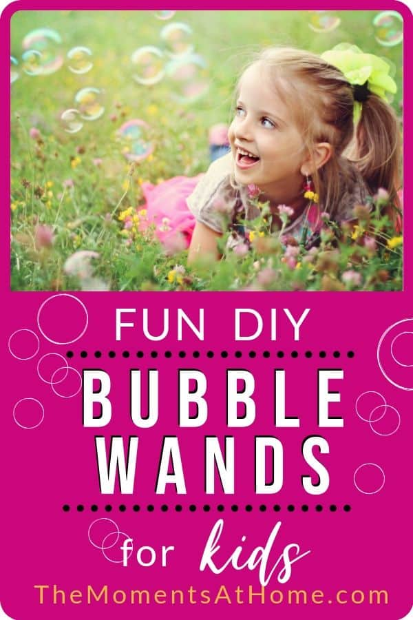 "girl in field of flowers looking at bubbles with text ""DIY Bubble Wands for kids"" by The Moments At Home"