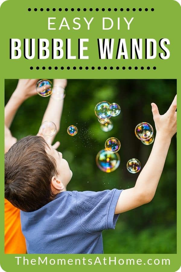 "boys catching bubbles outside with words ""easy DIY bubble wands"" from The Moments At Home"