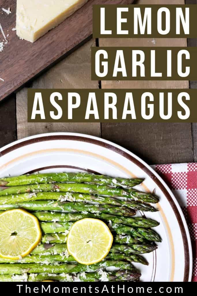 "plate of roasted asparagus with text ""lemon garlic asparagus"" by The Moments At Home"
