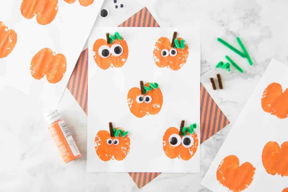 apple stamping autumn craft that looks like a pumpkin