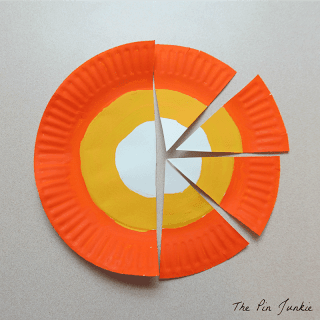 painted paper plate cut into wedges for a paper plate craft candy corn banner