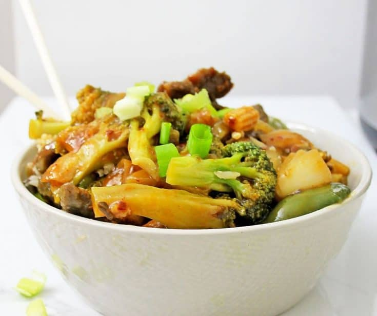 white bowl filled with Asian veggies and beef with garlic sauce