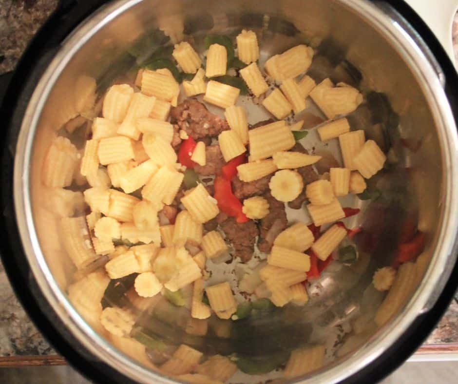 picture of Hunan beef and vegetables cooking in the Instant Pot liner before adding garlic sauce