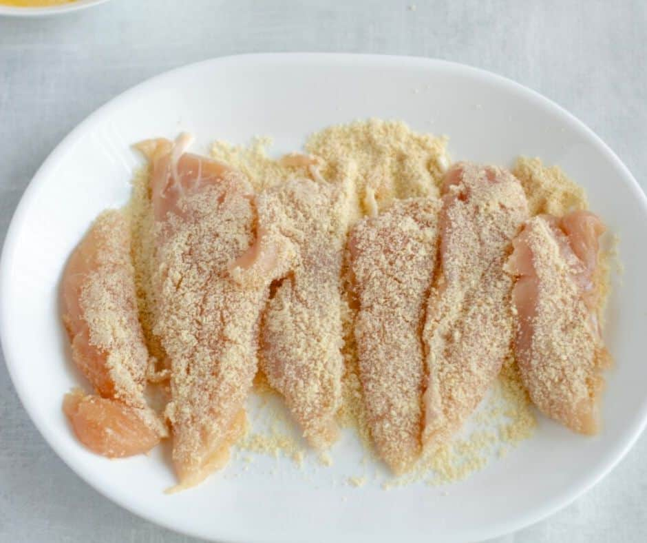 breaded chicken tenders waiting to be oven baked