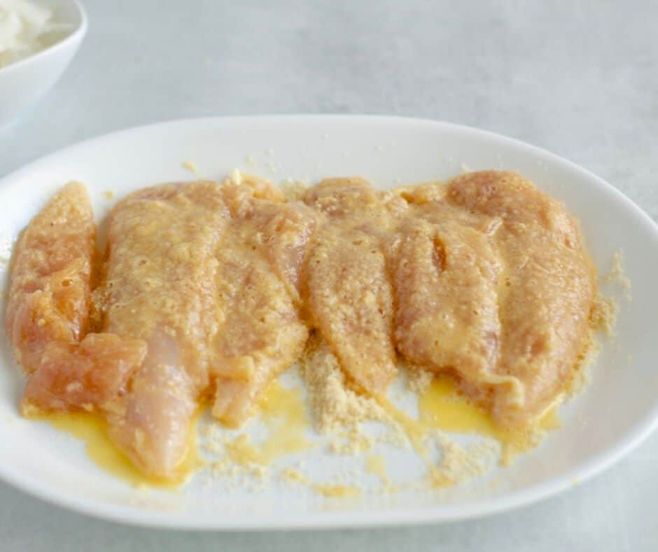 chicken tenders dredged in egg and low carb flour mix