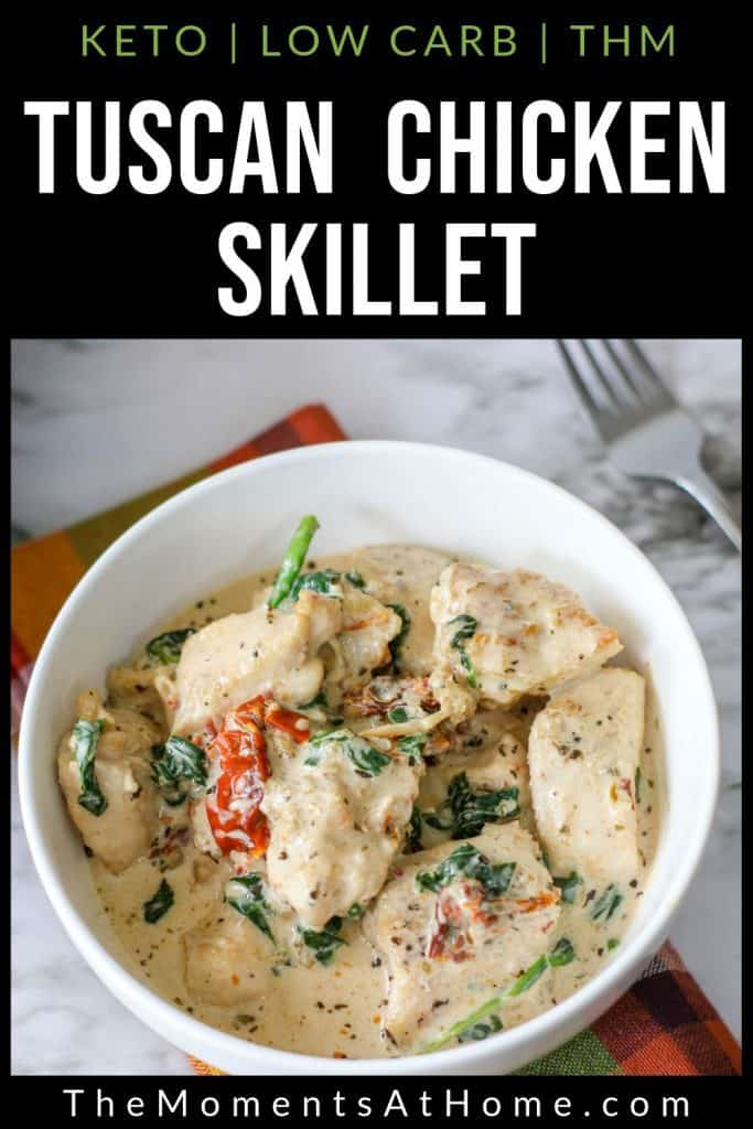 "bowl of keto tuscan chicken with garlic cream sauce, tomato, basil or spinach, and bacon with text ""tuscan chicken skillet: keto, low carb, THM"" by The Moments At Home"
