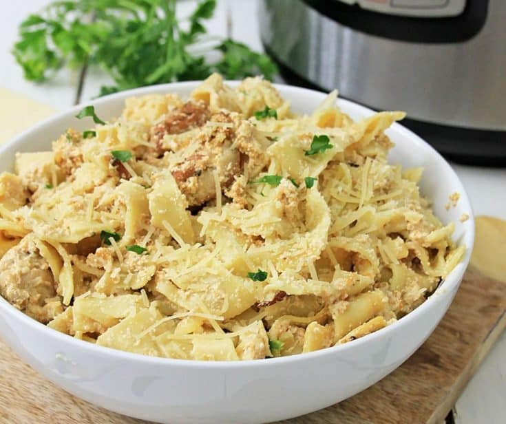 bowl of fettuccine chicken alfredo in front of instant pot