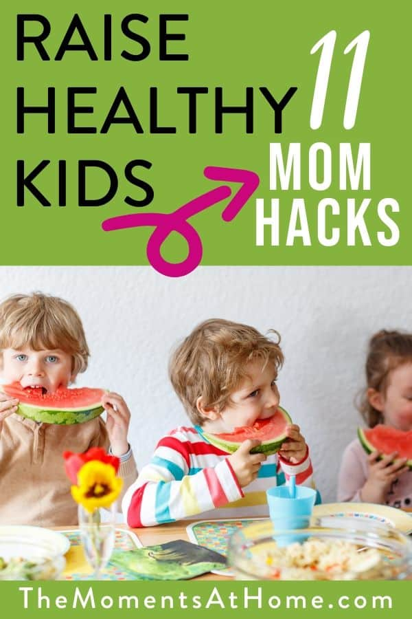 "kids eating fruit with text ""raise healthy kids with these 11 mom hacks"" by The Moments at Home"