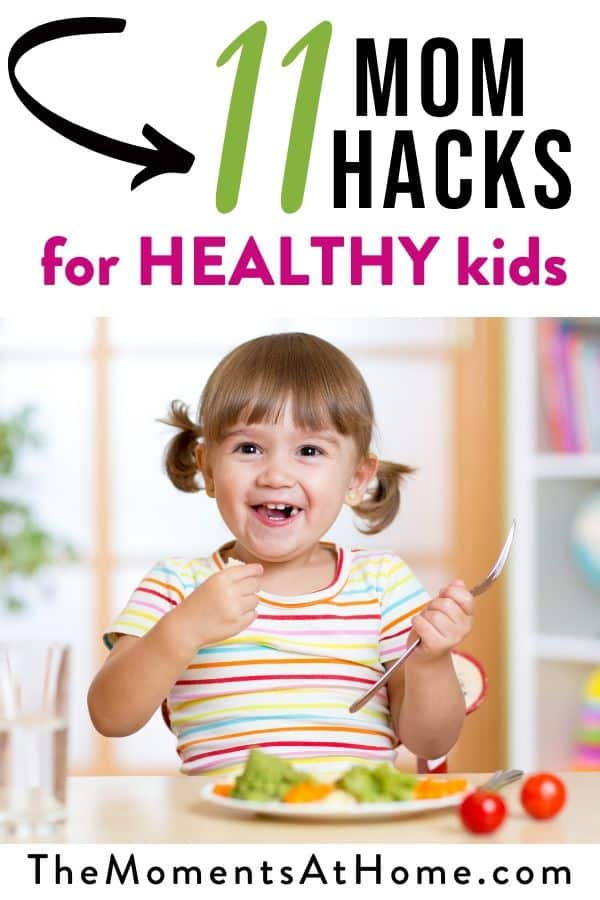"picture of toddler eating veggies with a smile and text ""11 Mom Hacks for HEALTHY kids"" by The Moments At Home"